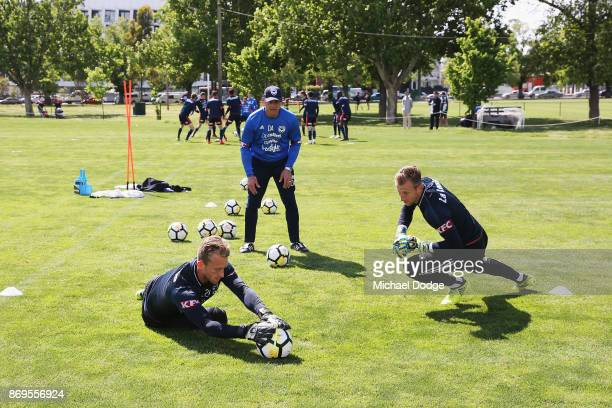 Goal keepers Victory goalkeeper Lawrence Thomas and Matt Acton dive for the ball during a Melbourne Victory ALeague training session at Gosch's...