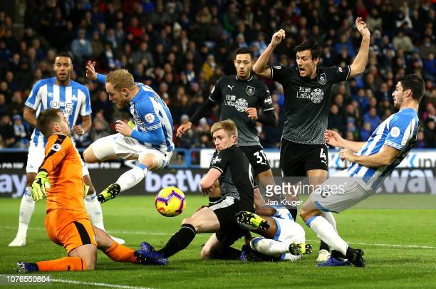 Goal mouth scramble including Christopher Schindler of Huddersfield Town, Ben Mee and Thomas Heaton of Burnley during the Premier League match...