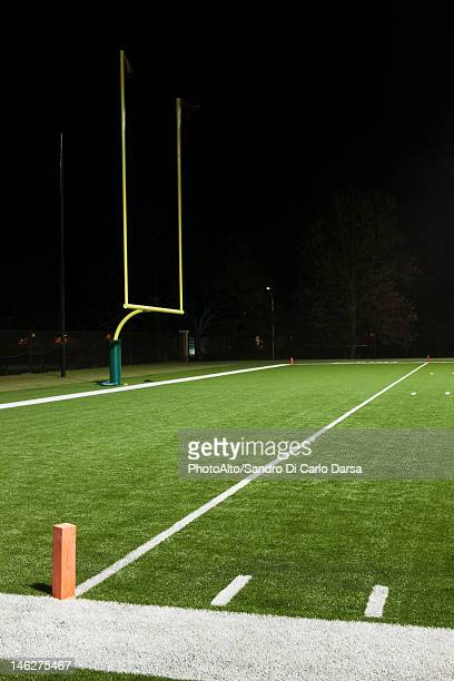 goal post on empty football field - goal post stock photos and pictures