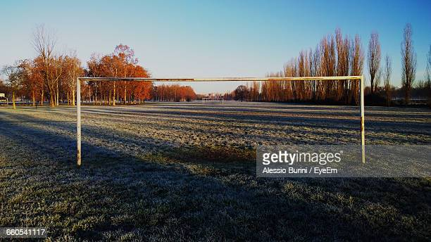 goal post on field against sky - goal post stock photos and pictures