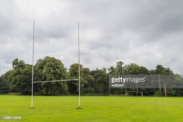 goal posts on a rugby pitch surrounded by trees - try scoring stock pictures, royalty-free photos & images