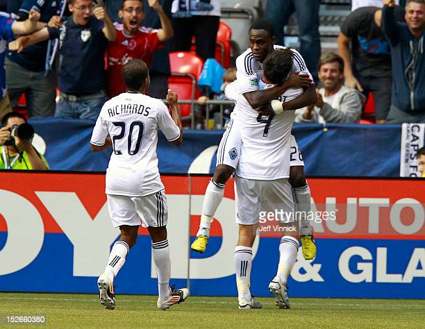Goal scorer Alain Rochat of the Vancouver Whitecaps FC is congratulated by Darren Mattocks while Dane Richards approaches against the Colorado Rapids...