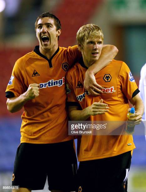 Goal scorer Andy Keogh of Wolverhampton Wanderers celebrates with team mate Stephen Ward at the final whistle during the Barclays Premier League...