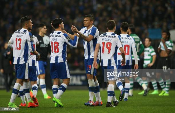 Goal scorer FC Porto's forward from Brazil Soares celebrates with teammate FC Porto's midfielder Joao Carlos Teixeira the victory at the end of the...