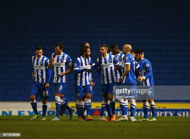 Goal scorer Joao Carlos Teixeira of Brighton and Hove Albion celebrates with team mates during the Sky Bet Championship match between Brighton Hove...
