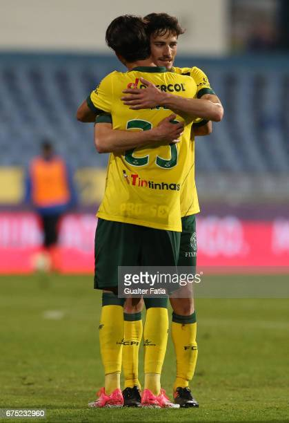 Goal scorer Pacos Ferreira's forward Vasco Rocha from Portugal celebrates the victory with teammate Pacos Ferreira's forward Ivo Rodrigues from...