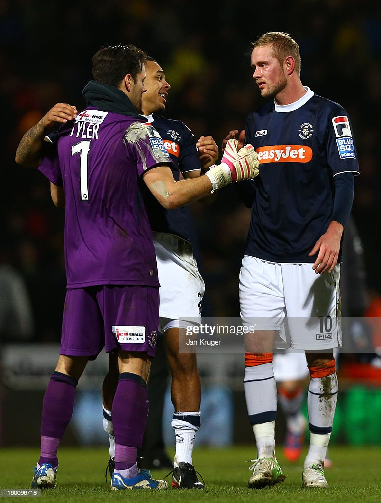 Goal scorer Scott Rendell (R) celebrates the win with team mate Mark Tyler, Goalkeeper of Luton Town, at the final whistle during the FA Cup with Budweiser fourth round match between Norwich City and Luton Town at Carrow Road on January 26, 2013 in Norwich, England.