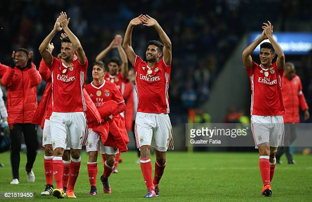 Goal scorer SL Benfica's defender from Argentina Lisandro Lopez celebrates with teammates the draw at the end of the Primeira Liga match between FC...