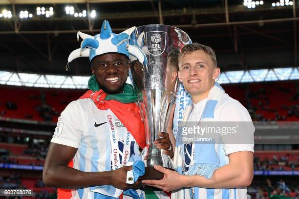 Goal scorers Gael Bigirimana and George Thomas of Coventry City celebrate with the trophy after winning the EFL Checkatrade Trophy Final between...