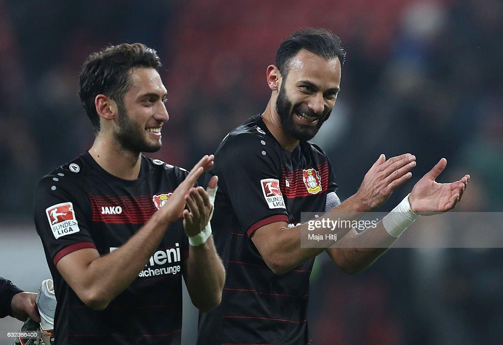Goal scorers Hakan Calhanoglu and mer Toprak of Leverkusen celebrate after the Bundesliga match between Bayer 04 Leverkusen and Hertha BSC at BayArena on January 22, 2017 in Leverkusen, Germany.
