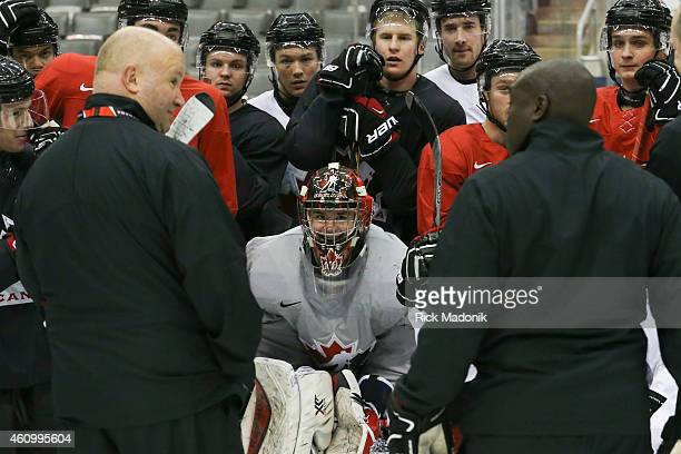 TORONTO JANUARY 3 Goal tender Eric Comrie and his team mates listen to head coach Benoit Groulx and others during the morning skate Team Canada...