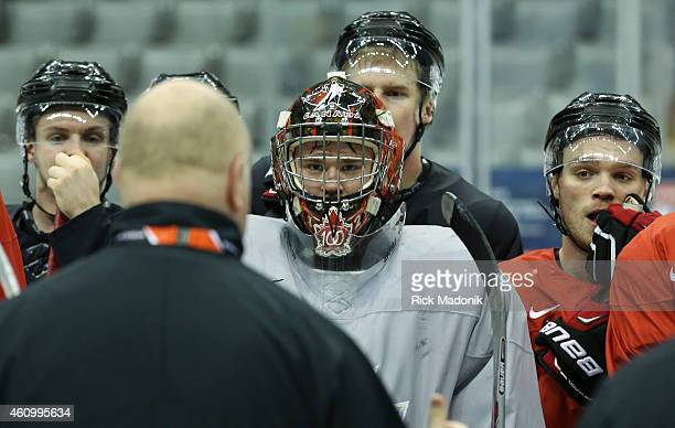 TORONTO JANUARY 3 Goal tender Eric Comrie and his team mates listen to head coach Benoit Groulx during the morning skate Team Canada practice at the...