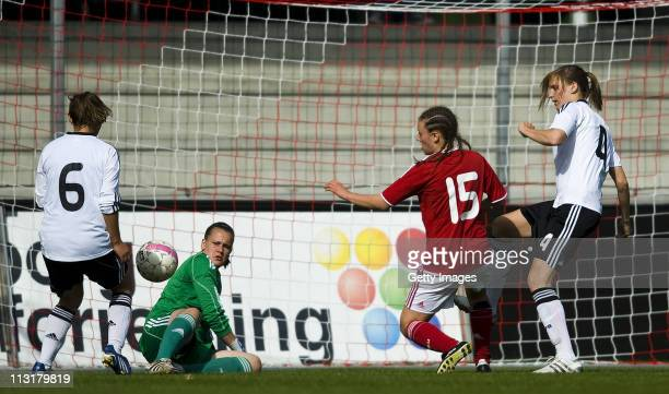 Goaleeper Friederike Abt of Germany and Lina Magull of Germany as well as Katharina Leiding of Germany and Laura Joest Jakobsen of Denmark battle for...