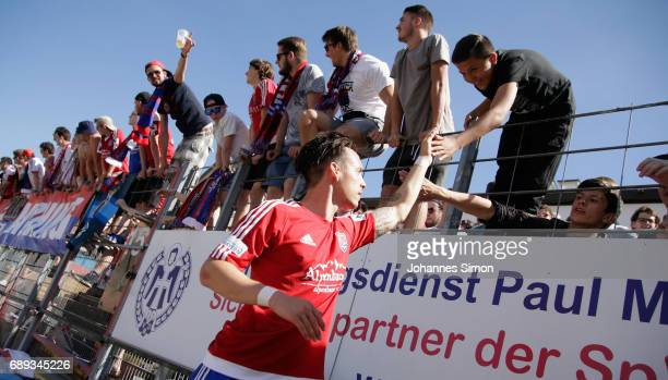 Goalgetter Thomas Steinherr of Unterhaching celebrates with fans after the third league playoff leg one match at Alenbauer Sportpark on May 28 2017...