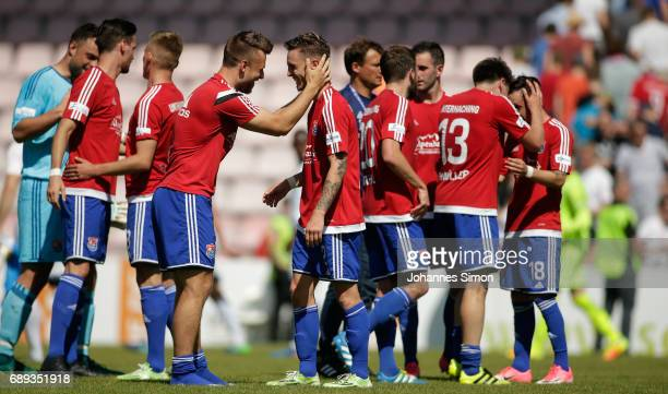 Goalgetter Thomas Steinherr of Unterhaching celebrates with team mates after the third league playoff leg one match at Alenbauer Sportpark on May 28...