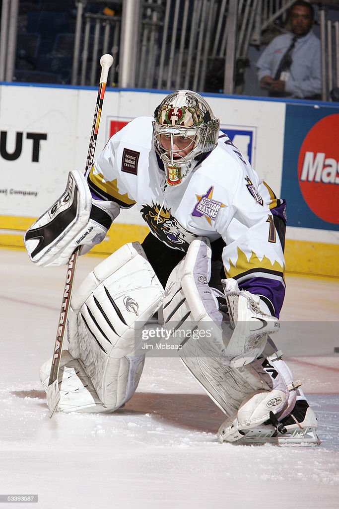 Goalie Adam Hauser #1 of the Manchester Monarchs stands outside the crease during the pregame skate around prior to a American Hockey League game against the Bridgeport Sound Tigers at the Arena at Harbor Yard on December 10, 2004 in Bridgeport, Connecticut. The Sound Tigers won 4-2.