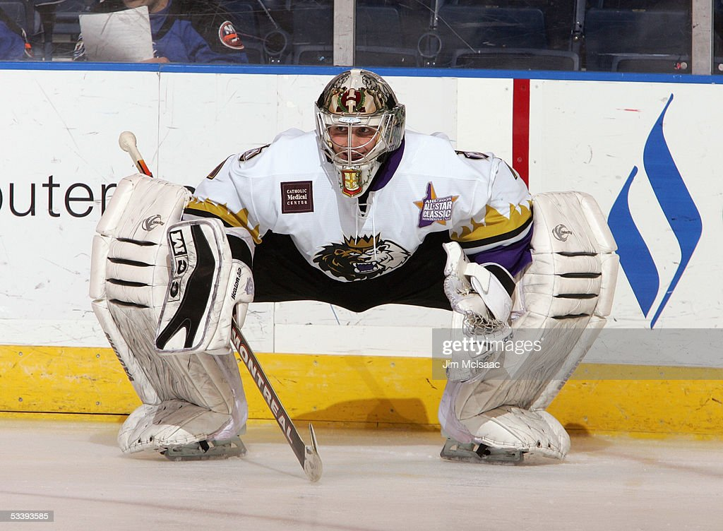 Goalie Adam Hauser #1 of the Manchester Monarchs stretches during the pregame skate around prior to a American Hockey League game against the Bridgeport Sound Tigers at the Arena at Harbor Yard on December 10, 2004 in Bridgeport, Connecticut. The Sound Tigers won 4-2.