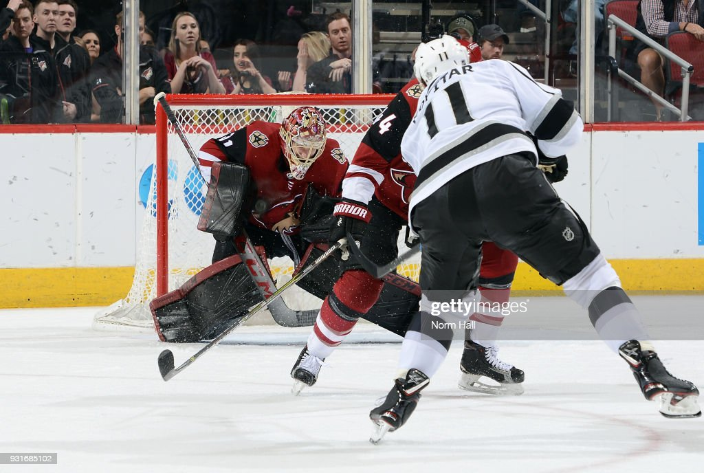 Goalie Adin Hill #31 of the Arizona Coyotes makes a save on the shot by Anze Kopitar #11 of the Los Angeles Kings during the third period at Gila River Arena on March 13, 2018 in Glendale, Arizona.