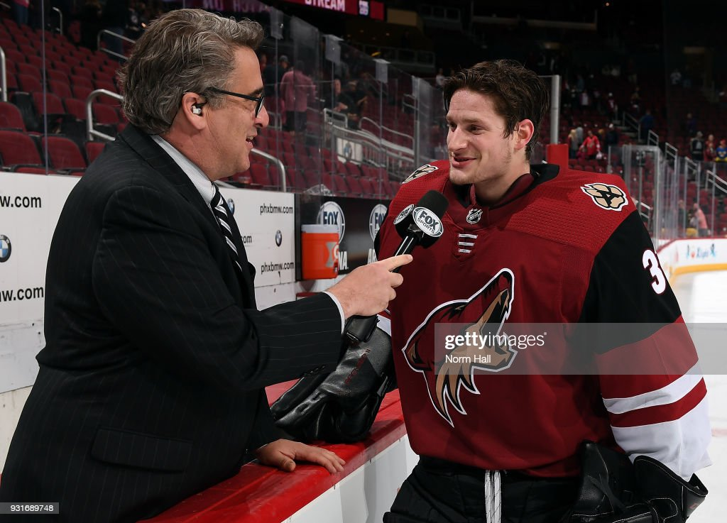 Goalie Adin Hill #31 of the Arizona Coyotes talks with local media after a 4-3 shootout victory against the Los Angeles Kings at Gila River Arena on March 13, 2018 in Glendale, Arizona. It was Hill's first career NHL win.
