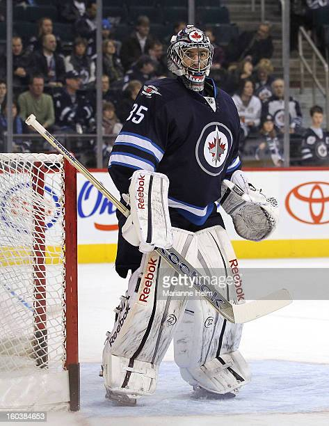 Goalie Al Montoya of the Winnipeg Jets gets his turn in net as the team warms up on the ice before a game against the New York Islanders on January...