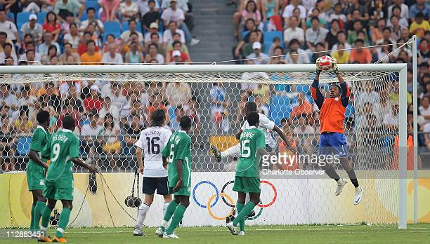 Goalie Ambruse Vanzekin of Nigeria stops a shot by the United States on Wednesday August 13 in a soccer qualifying round in the Games of the XXIX...