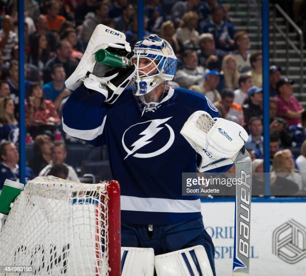 Goalie Anders Lindback of the Tampa Bay Lightning skates against the Philadelphia Flyers at the Tampa Bay Times Forum on April 10 2014 in Tampa...