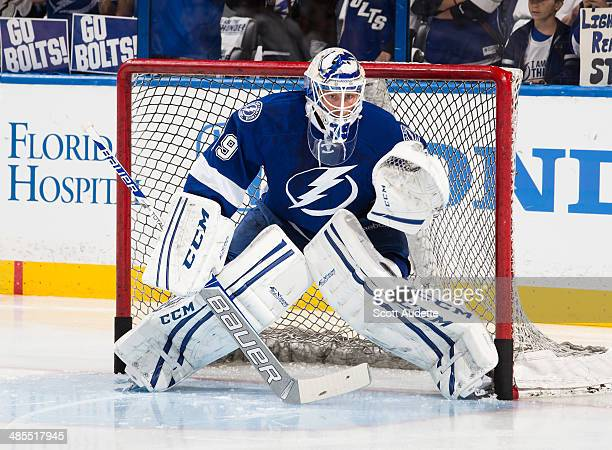 Goalie Anders Lindback of the Tampa Bay Lightning skates during the pre game warm ups prior to Game Two of the First Round of the 2014 Stanley Cup...