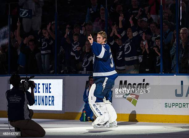 Goalie Anders Lindback of the Tampa Bay Lightning thanks fans for their support after being named the first star of the game against the Toronto...