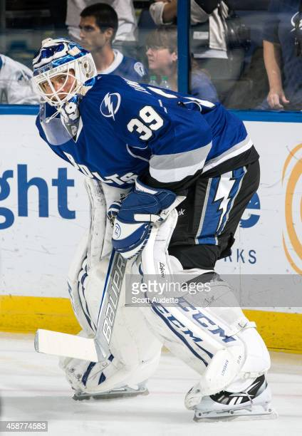 Goalie Anders Lindback of the Tampa Bay Lightning warms up prior to the game against of the Carolina Hurricanes at the Tampa Bay Times Forum on...