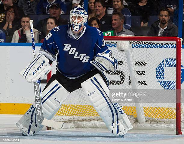 Goalie Anders Lindback of the Tampa Bay readies for a shot from the Winnipeg Jets at the Tampa Bay Times Forum on December 7 2013 in Tampa Florida