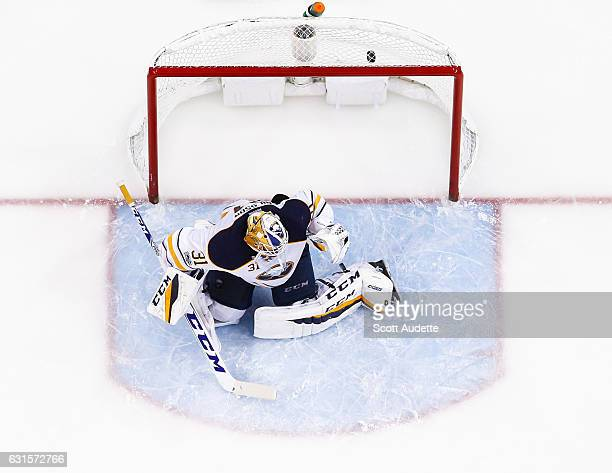 Goalie Anders Nilsson of the Buffalo Sabres gives up a goal against the Tampa Bay Lightning during the second period at Amalie Arena on January 12...