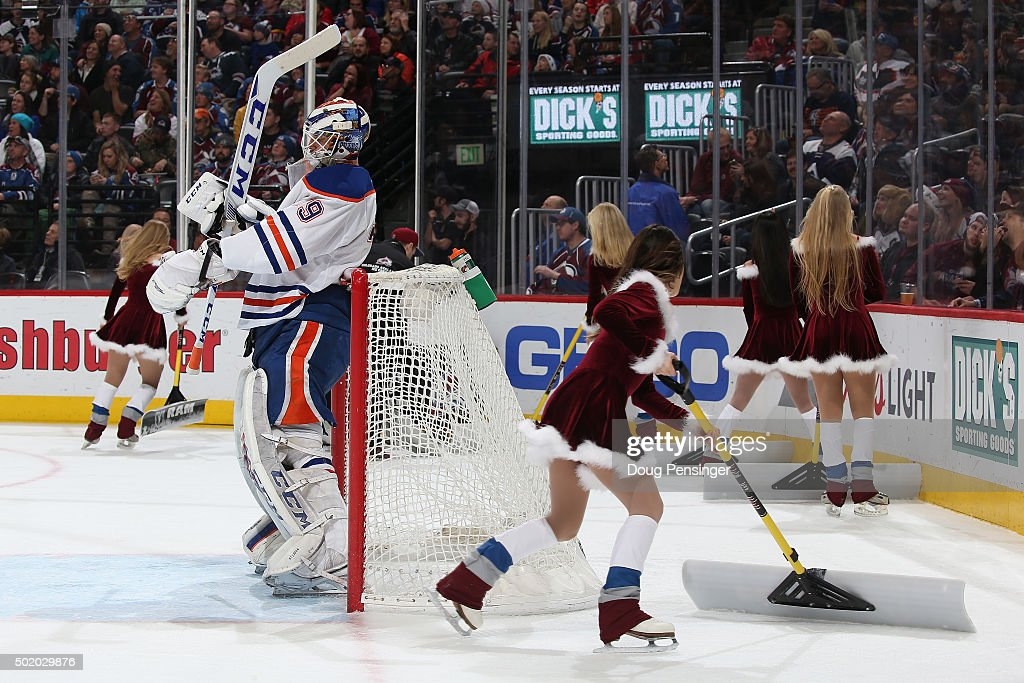 Goalie Anders Nilsson #39 of the Edmonton Oilers looks on as the Colorado Avalanche ice girls clean the ice during a break in the action as he defends the goal against the Colorado Avalanche at Pepsi Center on December 19, 2015 in Denver, Colorado. The Avalanche defeated the Oilers 5-1.
