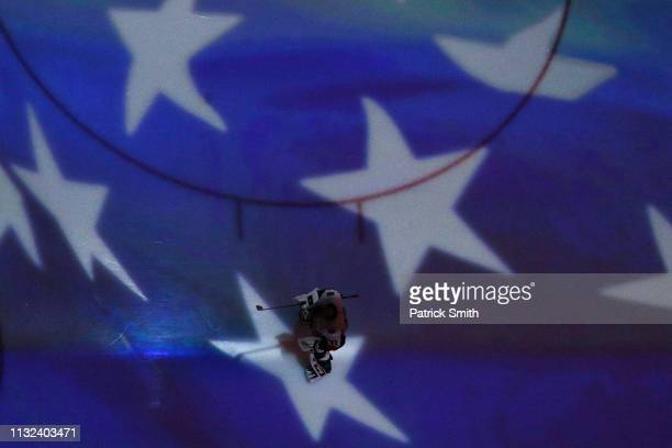 Goalie Anders Nilsson of the Ottawa Senators stands during the US National Anthem before playing against the Washington Capitals during at Capital...