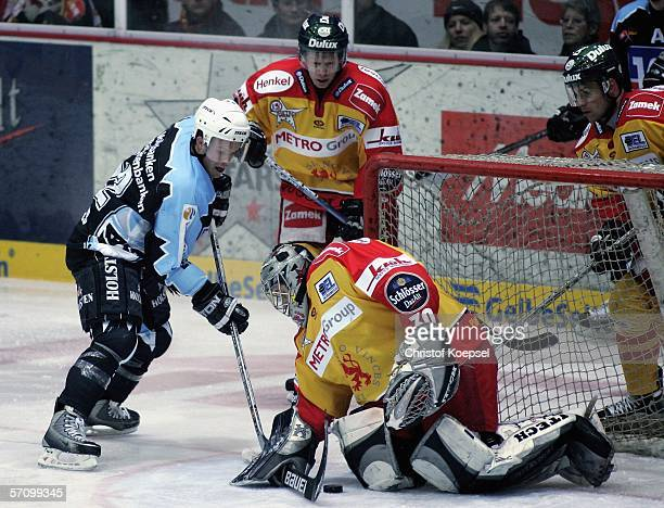 Goalie Andrei Trefilov of the Metro Stars catches the puck before Jeff Ulmer of the Freezers during the Play Off quarter final match between DEG...