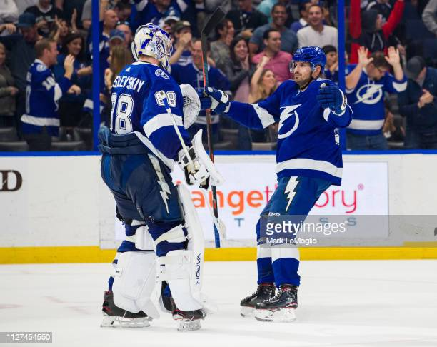 Goalie Andrei Vasilevskiy and Alex Killorn of the Tampa Bay Lightning celebrate the shootout win against the Los Angeles Kings at Amalie Arena on...