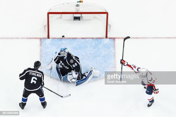 Goalie Andrei Vasilevskiy and Anton Stralman of the Tampa Bay Lightning react to giving up a goal against Justin Williams and the Washington Capitals...