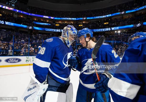 Goalie Andrei Vasilevskiy and Brayden Point of the Tampa Bay Lightning celebrate the win against the Columbus Blue Jackets at Amalie Arena on January...