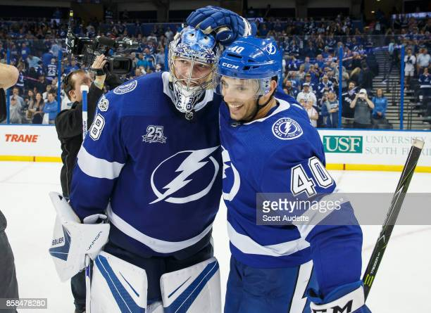 Goalie Andrei Vasilevskiy and Gabriel Dumont of the Tampa Bay Lightning celebrate the win against the Florida Panthers at Amalie Arena on October 6...