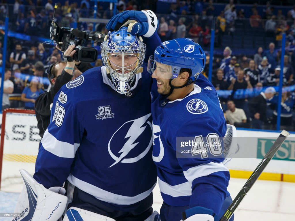 Goalie Andrei Vasilevskiy #88 and Gabriel Dumont #40 of the Tampa Bay Lightning celebrate the win against the Pittsburgh Penguins at Amalie Arena on October 12, 2017 in Tampa, Florida.