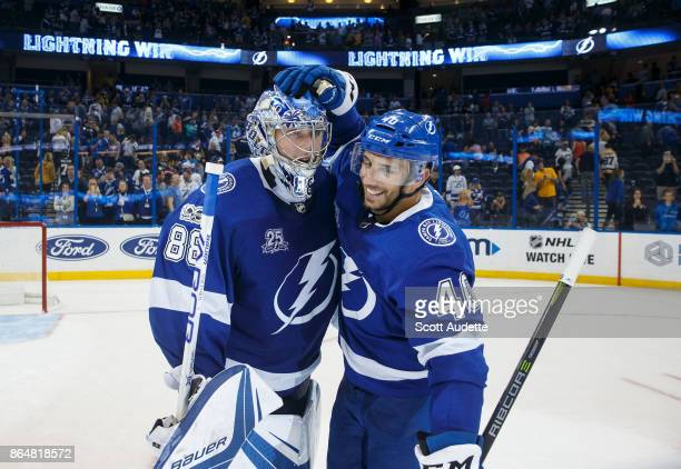 Goalie Andrei Vasilevskiy and Gabriel Dumont of the Tampa Bay Lightning celebrate the win against the Pittsburgh Penguins at Amalie Arena on October...