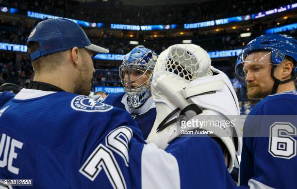 Goalie Andrei Vasilevskiy and Louis Domingue of the Tampa Bay Lightning celebrate the win against the Detroit Red Wings at Amalie Arena on February...
