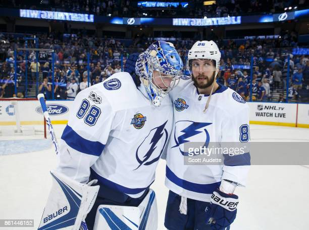 Goalie Andrei Vasilevskiy and Nikita Kucherov of the Tampa Bay Lightning celebrate the win against the St Louis Blues at Amalie Arena on October 14...