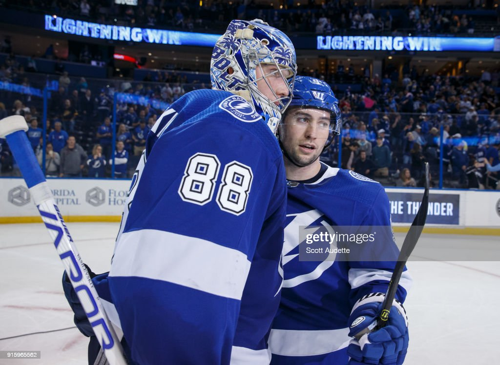 Goalie Andrei Vasilevskiy #88 and Tyler Johnson #9 of the Tampa Bay Lightning celebrate the win against the Vancouver Canucks at Amalie Arena on February 8, 2018 in Tampa, Florida.