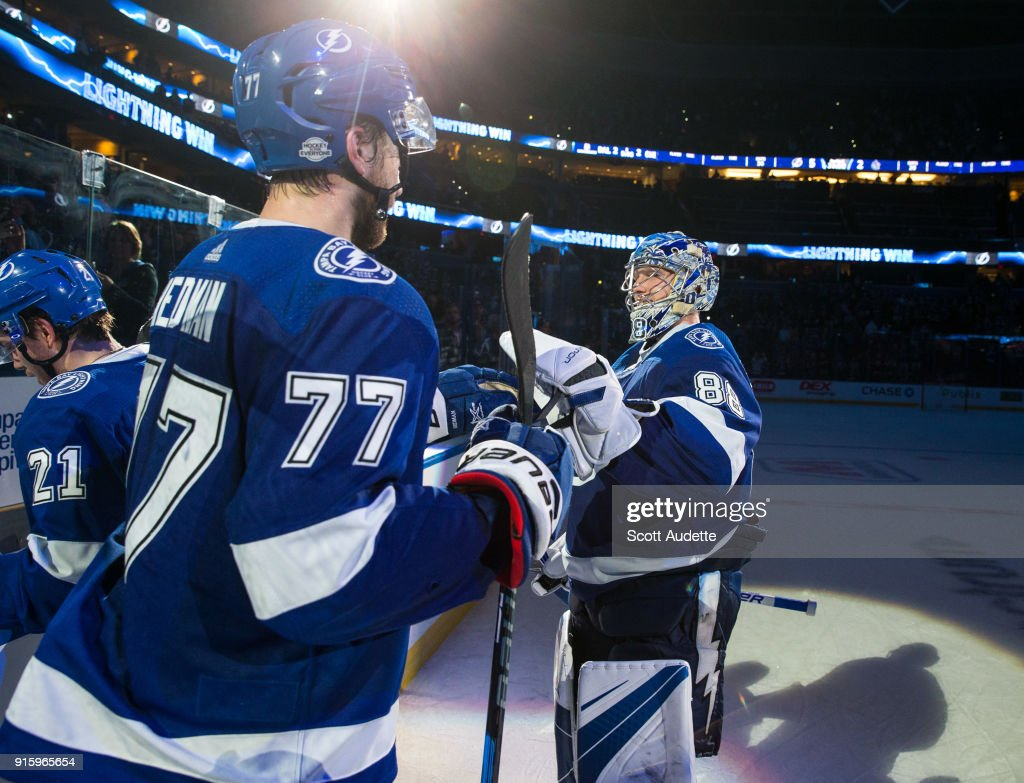 Goalie Andrei Vasilevskiy #88 and Victor Hedman #77 of the Tampa Bay Lightning celebrate the win against the Vancouver Canucks at Amalie Arena on February 8, 2018 in Tampa, Florida.