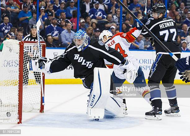 Goalie Andrei Vasilevskiy and Victor Hedman of the Tampa Bay Lightning watches the puck go into the net for a goal for Jiri Hudler and the Florida...