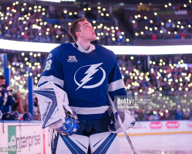 Goalie Andrei Vasilevskiy of the Tampa Bay Lightning and the Chicago Blackhawks observes a moment of silence in hockeys fight against cancer as fans...