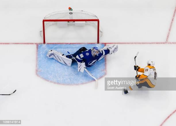 Goalie Andrei Vasilevskiy of the Tampa Bay Lightning gives up a goal against Calle Jarnkrok of the Nashville Predators during the third period at...