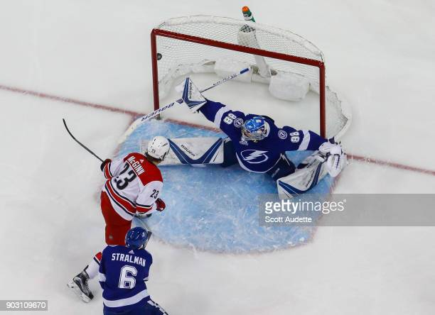 Goalie Andrei Vasilevskiy of the Tampa Bay Lightning gives up a goal to Brock McGinn of the Carolina Hurricanes during the first period at Amalie...