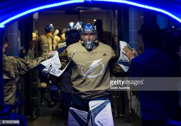 Goalie Andrei Vasilevskiy of the Tampa Bay Lightning is greeted my members of the military before the pregame warm ups against the Dallas Stars at...