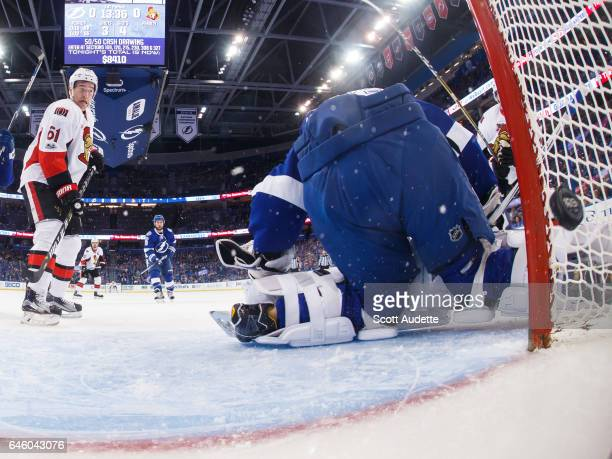 Goalie Andrei Vasilevskiy of the Tampa Bay Lightning lets the puck slip by for a goal for Mark Stone and Derick Brassard of the Ottawa Senators...